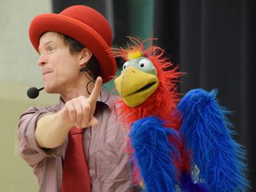 Tim Holland performing at Perth school